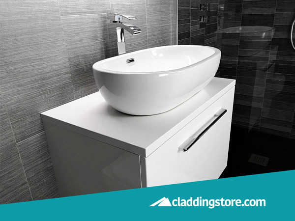 PROPANEL® Grey Graphite Modern Large Tile used to clad behind a white bathroom basin.