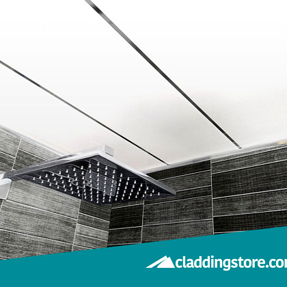 PROPANEL® Single Inlay Chrome 8mm installed to a ceiling in showroom alongside a grey tile effect cladded bathroom wall.