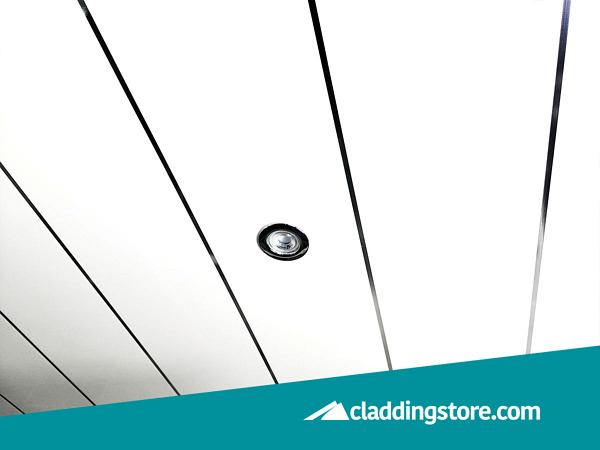 PROPANEL® Single Inlay Chrome 8mm installed to a ceiling in showroom.